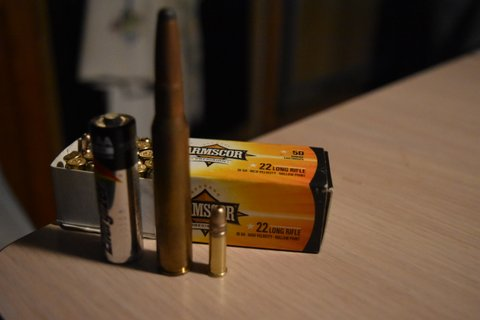 .22 LR compared to AA battery and a .30-06