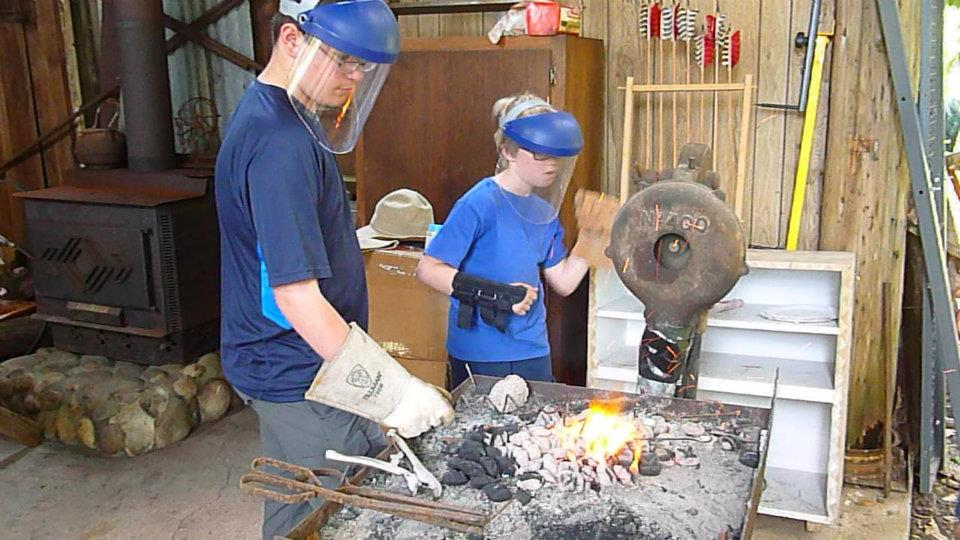 Preteens In the Blacksmith Shop Fabricating a Rope Making Machine